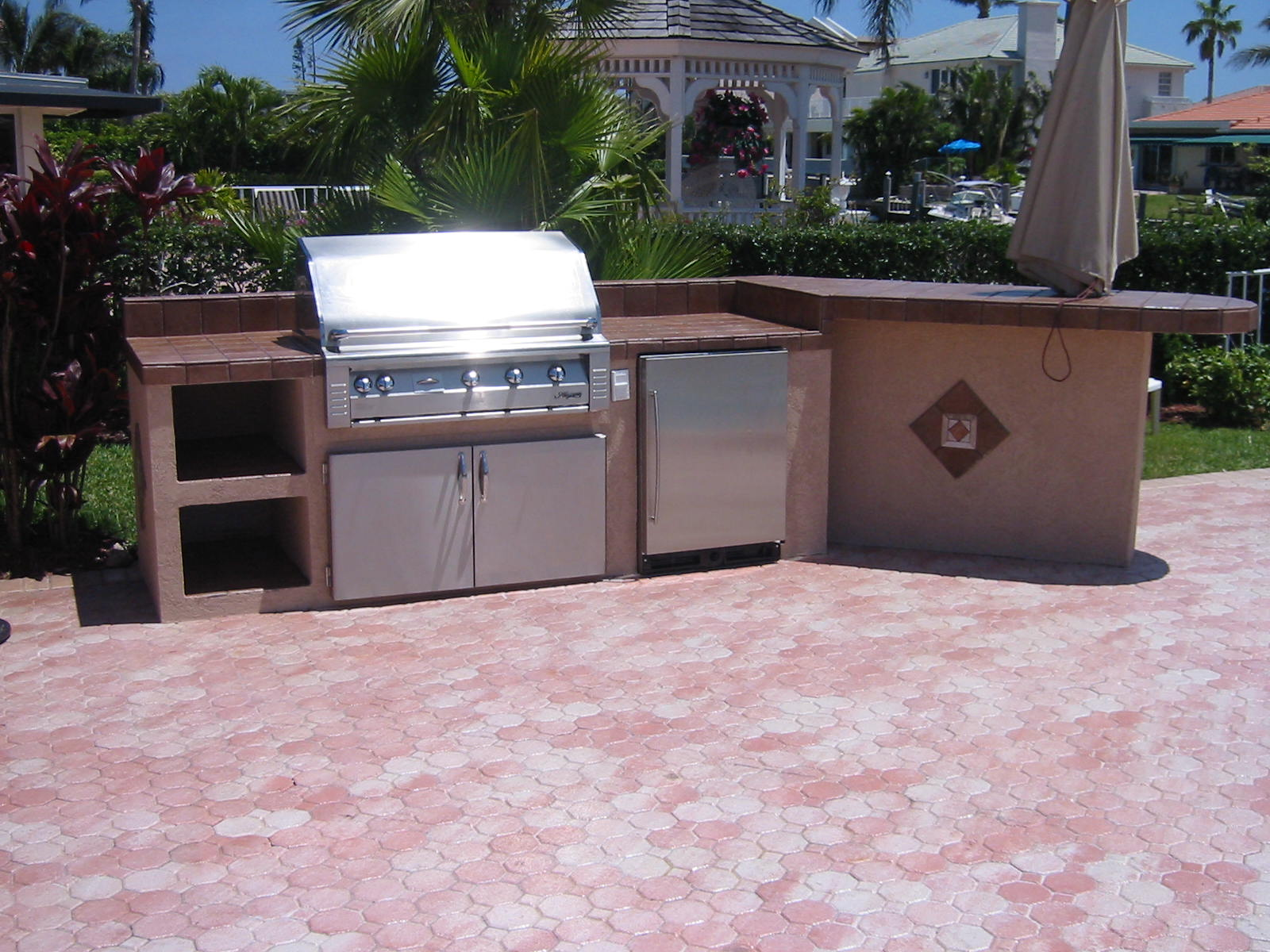 Custom grill island with alfresco gas grill built in doors and ul